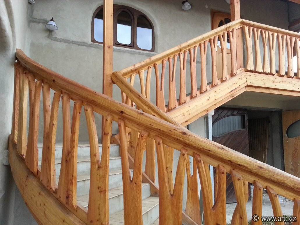 Detail of hand made staircase and railing from larch wood.