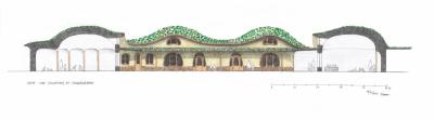 Waldorfská mateřská školka, pohled z jižní strany s částečným řezem dvěma třídami. Organicky tvarovaná zaoblená architektura odpovídá potřebám dítěte v prvním sedmiletí. Budovy mají zelené střechy a přesahy střech nad velkými okny. To pomáhá stínit interiér v letním období.