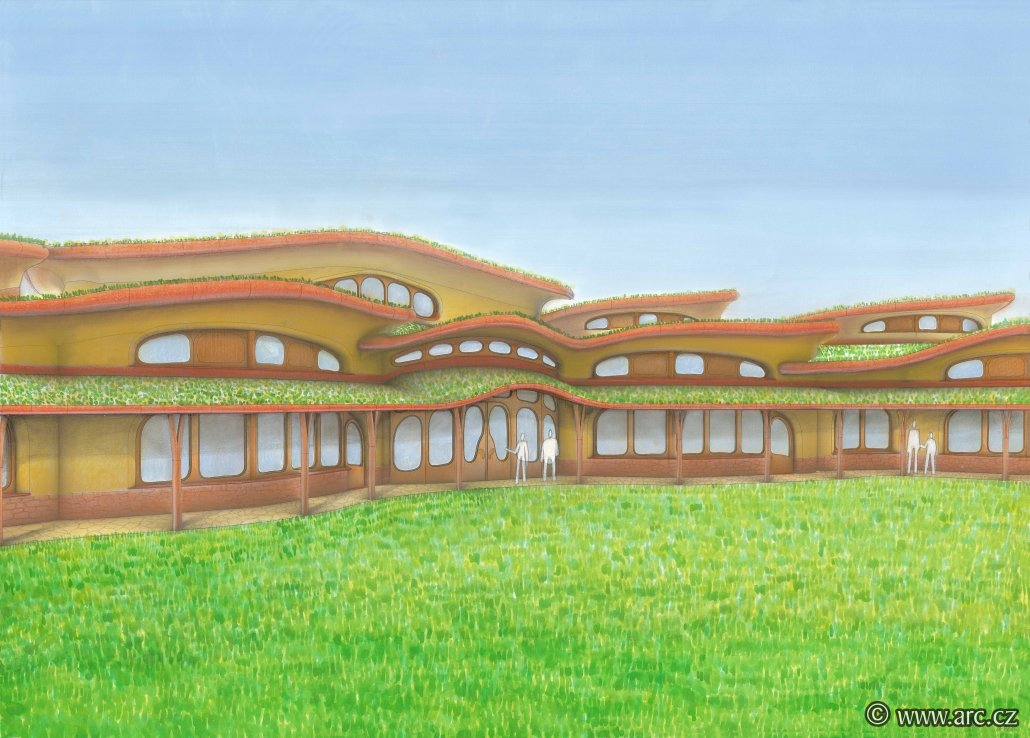Detail view of the roofs of the Waldorf school. View from the southwest side. Organically shaped roofs correspond to the character of the surrounding landscape. In the middle we see an elevated part in the background, where there is a gym and a school hall. The lowered roof in the foreground, where the entrance to the school is, protects the south windows from summer overheating.